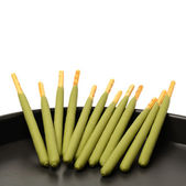 Sticks in tray — Stock Photo
