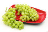 Red bowl of  grapes — Stock Photo
