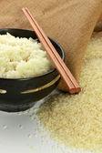 Rice in black bowl — Stock Photo