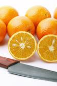 Oranges with knife — Zdjęcie stockowe