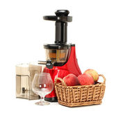 Slow juicer with peaches — Stock Photo