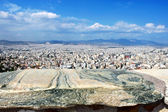 Big massive stone in the fence of the Acropolis with views over Athens and the mountains — Stock Photo