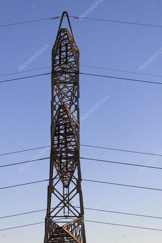 High tension electrical tower side faced, background smooth blue sky. — Stock Photo #19385311