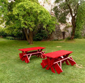 Red tables and benches — Stock Photo