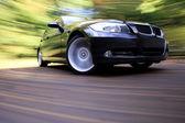 Black luxury sedan — Stock Photo