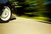 View of black luxury sedan driving fast. — Stok fotoğraf