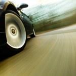 View of black luxury sedan driving fast. — Stock Photo #32710347