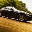 View of Luxury sedan with blurred motion. — Stock Photo