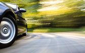 Front side view of luxury sedan — Stock Photo