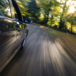 Side view of speeding sedan — Stock Photo #37428579