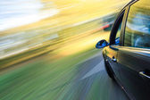 Side view of speeding sedan. — Stock Photo