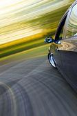 Side view of speeding sedan — Stock Photo