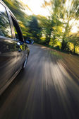 Side view of speeding sedan — Stock Photo