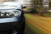 Front side view of speeding car — Stock Photo
