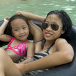 Foto Stock: Two Girls Tube Floating
