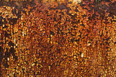 Rusty yellow paint on metal plate — Stock Photo