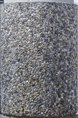 Pebbles on a concrete column — Stock Photo