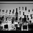 Bar with alcohol bottles — Stock Photo