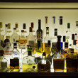 Bar with alcohol bottles — Stock Photo #14322451