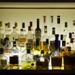 Stock Photo: Bar with alcohol bottles