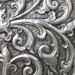 Metallic texture embossed into an ancient doorway — Stock Photo