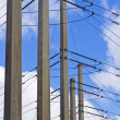 Stock Photo: Powerlines with vivid blue background