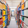 Library setting with books and reading material - Stock fotografie
