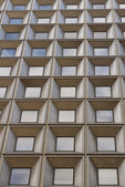 Windows with an architectural geometric construction — Photo