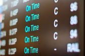 Airport monitor with different air traffic words signalling the state of a certain flight. — Stock Photo