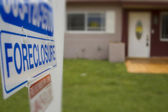 A foreclosure sign outside of a condemned home — Stock Photo