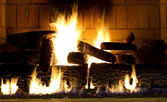 Warm fireplace with a fire started — Stock Photo