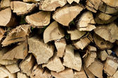 Firewood piled high — Stock Photo