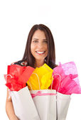Young woman holding gift bags — Stock Photo