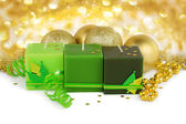 Christmas background - green candles and boubles — Stock Photo