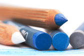 Gray abd blue oil pastels and watercolor pencils — Stock Photo