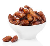Fresh dates in bowl isolated — Stock Photo