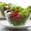Healthy food - salad with mozzarella, arugula and tomatoes — Stock Photo