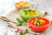 Delicious cold red and green gazpacho soup with garlic croutons — Stock Photo