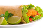 Chicken tortilla wrap with lime and chili sauce on the plate — Stock Photo