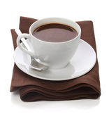 Hot chocolate in white cup on brawn table-napkin — Stock Photo