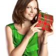 Young smiling woman in green dress with a gift box — Stock Photo