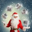 Santa Claus making magic in a snow — Stock Photo #37393415