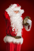 Santa Claus holding a clock showing several minutes to midnight — Stock Photo