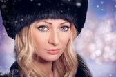 Portrait of beautiful woman in a fur hat — Foto Stock