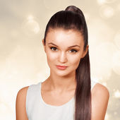 Young female with healthy shining brown hairs put in pony tail. — Stock Photo