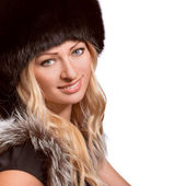 Portrait of beautiful woman in a fur hat — Stock Photo