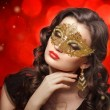 Young beautiful woman in golden carnival mask. — Stock Photo