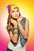 Portrait of cute girl in jeans vest and bandana  — Stock Photo