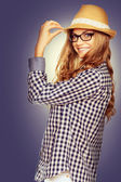 Portrait of a cute young woman wearing retro clothes, hat  and r — Stock Photo