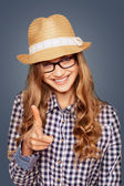 portrait of a smiling young woman with casual garb pointing a f — ストック写真